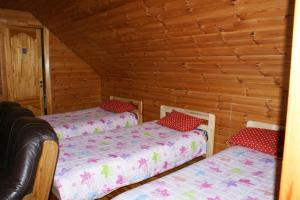 A bed or beds in a room at Lielie Kupri