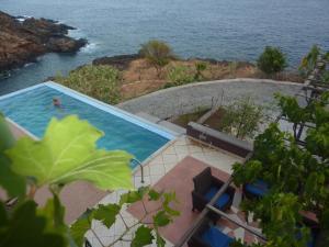 Uitzicht op het zwembad bij Villa Halcyon Caboverde of in de buurt