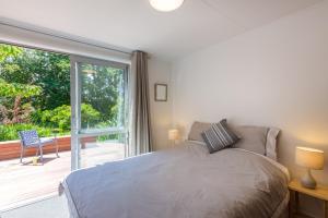 Posteľ alebo postele v izbe v ubytovaní Tui Cottage