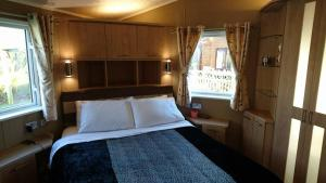 A bed or beds in a room at St. James 28 at Marton Mere