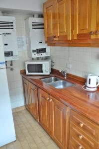 Una cocina o kitchenette en Calido departamento en el centro