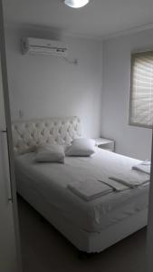 Cama o camas de una habitación en Residencial Talismã