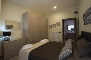Cama ou camas em um quarto em Le Cupoline