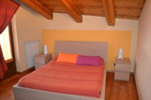 A bed or beds in a room at Baita Deserè