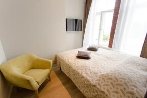 Vuode tai vuoteita majoituspaikassa Apple Apartments