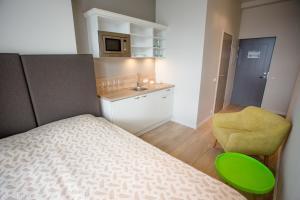 Majoituspaikan Apple Apartments keittiö tai keittotila