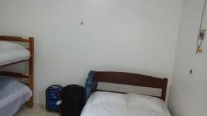 Cama o camas de una habitación en Residencial Dom Luiz