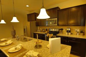 A kitchen or kitchenette at Disney Villa 6Bd/5Ba for 13 sleeps pool/spa