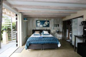 A bed or beds in a room at Vakantie Studio Grou
