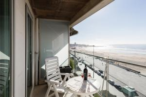 A balcony or terrace at Sea View Apartment Carlos Carvalho