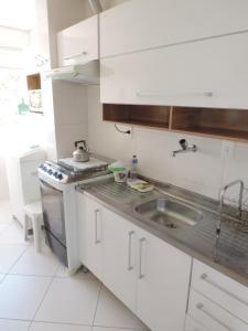 Una cocina o zona de cocina en Apartamento Residencial Ghanem