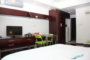 تلفاز و/أو أجهزة ترفيهية في World Union Service Apartment - Cosmo