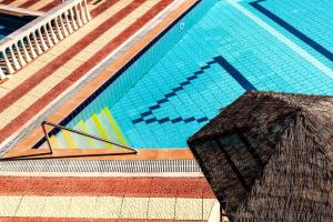 The swimming pool at or near Haroula Apartments