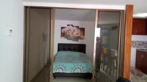 Cama o camas de una habitación en Apartahotel Calle del tiempo detenido