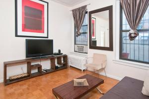 A television and/or entertainment center at Park Ave Apartments Midtown Next to Times Square
