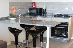 Una cocina o zona de cocina en Cabañas Bellavista del Sur