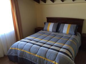 Cama o camas de una habitación en Cabañas Bellavista del Sur