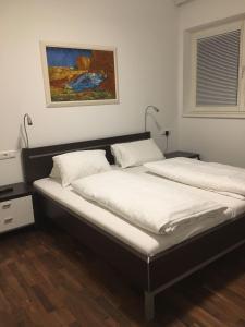 Ein Bett oder Betten in einem Zimmer der Unterkunft Appartement Feinsinn