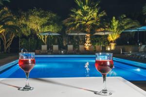 Piscine de l'établissement The Palm Garden Andreas Villas Golf ou située à proximité