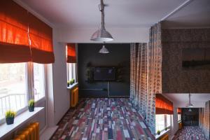 Телевизор и/или развлекательный центр в Apartment Kalina at Kirova 18