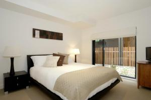 A bed or beds in a room at C-Scape Apartment 1