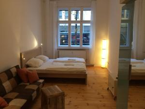 A bed or beds in a room at Lodge Berlin - Apartments