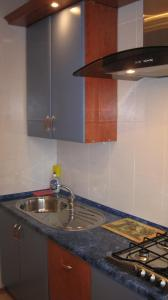 A kitchen or kitchenette at Apartments on Kozhara 5