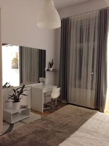 A television and/or entertainment center at Silhouette Downtown Apartment