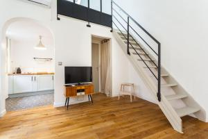 A television and/or entertainment center at Private Duplex Old Town