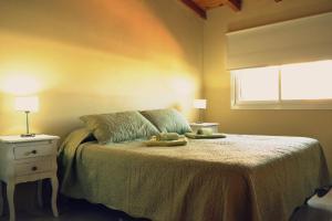 Una cama o camas en una habitación de Balcones del Sol