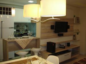 A kitchen or kitchenette at Apartamento Aeroporto
