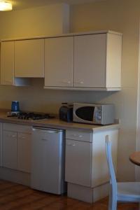 Küche/Küchenzeile in der Unterkunft Apartamentos Castell Sol