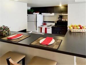 Hawthorn Suites by Wyndham Kent, WA 주방 또는 간이 주방
