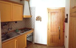 A kitchen or kitchenette at Residence Paradiso