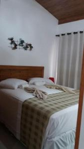 A bed or beds in a room at Solar Agua Apartamentos