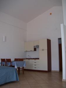A kitchen or kitchenette at Resort Isola Rossa