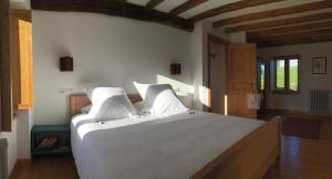 A bed or beds in a room at Casa Xabú