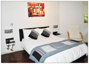 Cama o camas de una habitación en Santiago Suite Apartment