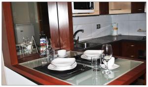 A cozinha ou cozinha compacta de Santiago Suite Apartment