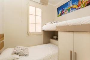 A bunk bed or bunk beds in a room at Casa Cosi Marina II