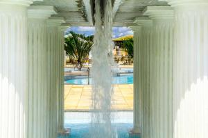 A view of the pool at Apartamentos L'acqua Diroma or nearby