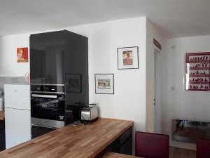 Cuisine ou kitchenette dans l'établissement Gite duplex du vignoble Alsace