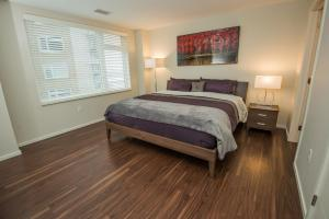 A bed or beds in a room at Nova Suites Inc.