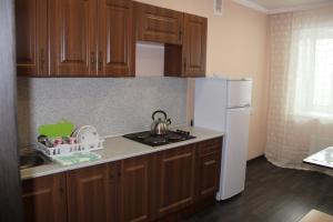 Кухня или мини-кухня в Апартаменты на Суворова 161