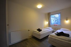 Een bed of bedden in een kamer bij Wadanders