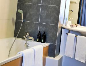 Ванная комната в Aparthotel Adagio Nantes Centre