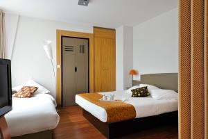 Кровать или кровати в номере Aparthotel Adagio Nantes Centre