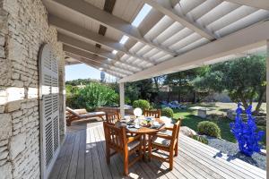 Restaurant ou autre lieu de restauration dans l'établissement Villa Le Lagon - Vision Luxe