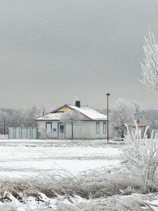 Haus Sonnensegel im Winter