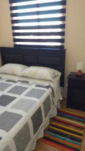 Cama o camas de una habitación en Cabañas del Profe, Puerto Montt